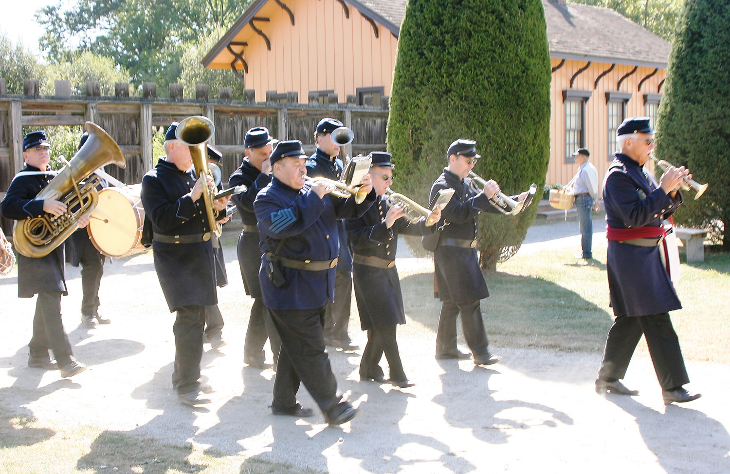The village's brass band steps smartly in a rousing patriotic salute.