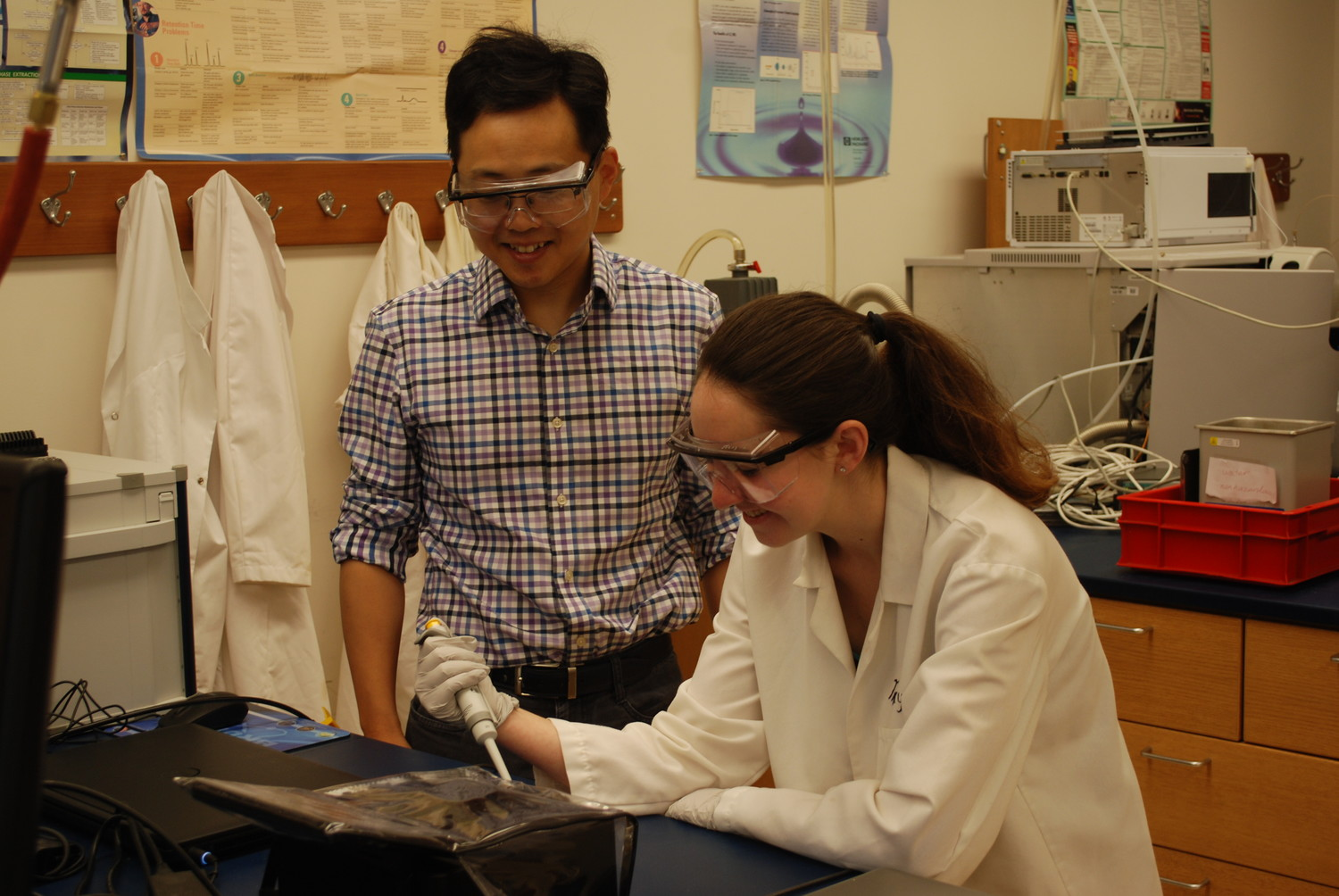 Hofstra Professor Ling Huang, left, has mentored incoming senior Nicole Homburger in multiple scientific pursuits. He was honored by Hofstra University on May 18 as its 2018 Mentor of the Year.