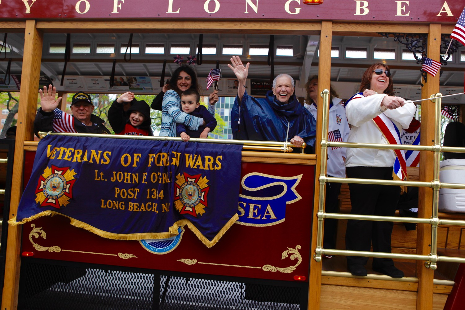 Members of the Long Beach Veterans of Foreign Wars Post 1384 and residents waved to onlookers from the trolley during last year's parade.
