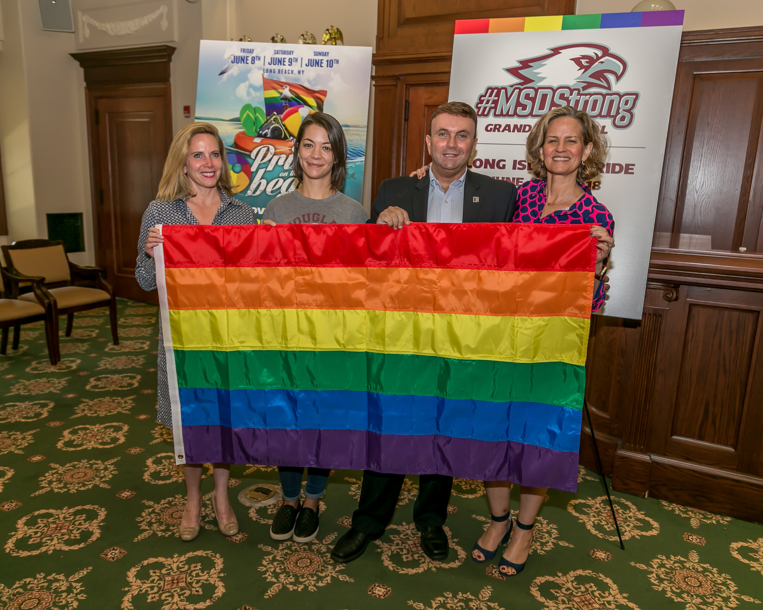 Hempstead Town Supervisor Laura Gillen, left, was joined by Gwen Gossler — the late Scott Beigel's fiancée — Chief Executive Officer of the LGBT Network David Kilmnick and County Executive Laura Curran at Monday's press conference.