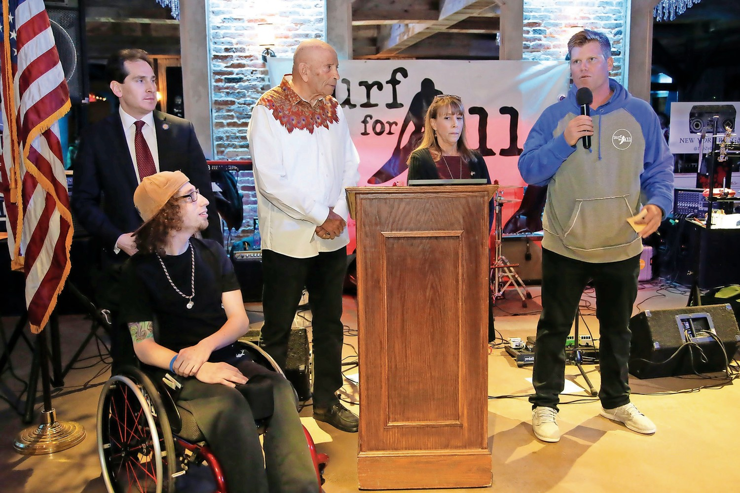 "Dylan ""The Surfing Samurai"" Hronec, far left, State Sen. Todd Kaminisy, former state Assemblyman Harvey Weisenberg, Assemblywoman Missy Miller, and Surf for All Co-founder Cliff Skudin at the April 20 Surf for All fundraiser at The Loft in Island Park, where Skudin thanked supporters."