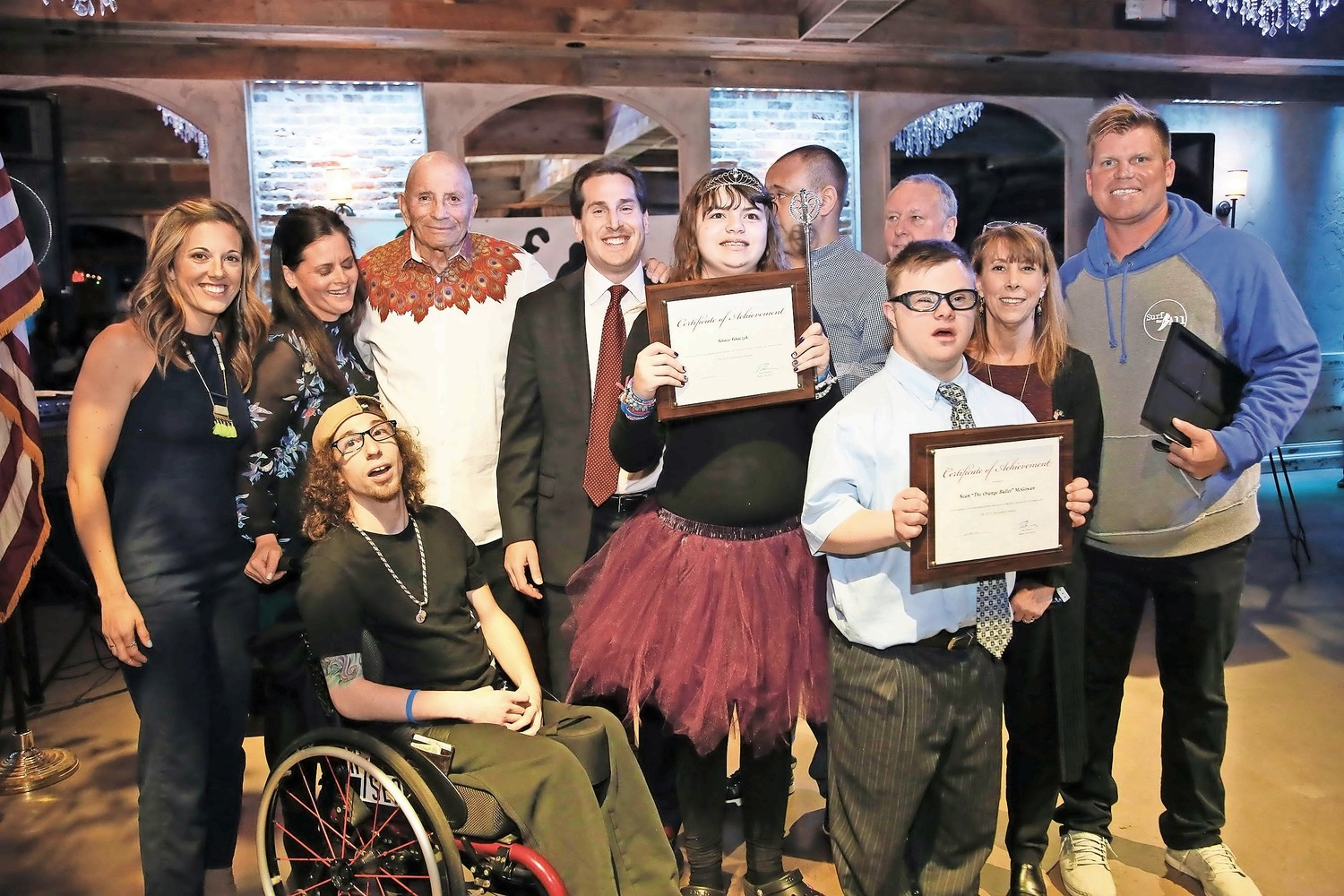 "Grace Graczyk and Sean ""The Orange Bullet"" McGowan, center, were awarded with Certificates of Achievement."