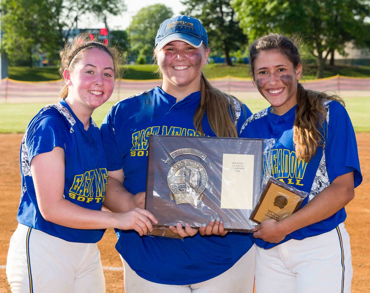 East Meadow senior captains, from left, Sara Polansky, Christina Loeffler and Sam Reyes displayed the county championship hardware after winning a second straight Nassau Class AA title.