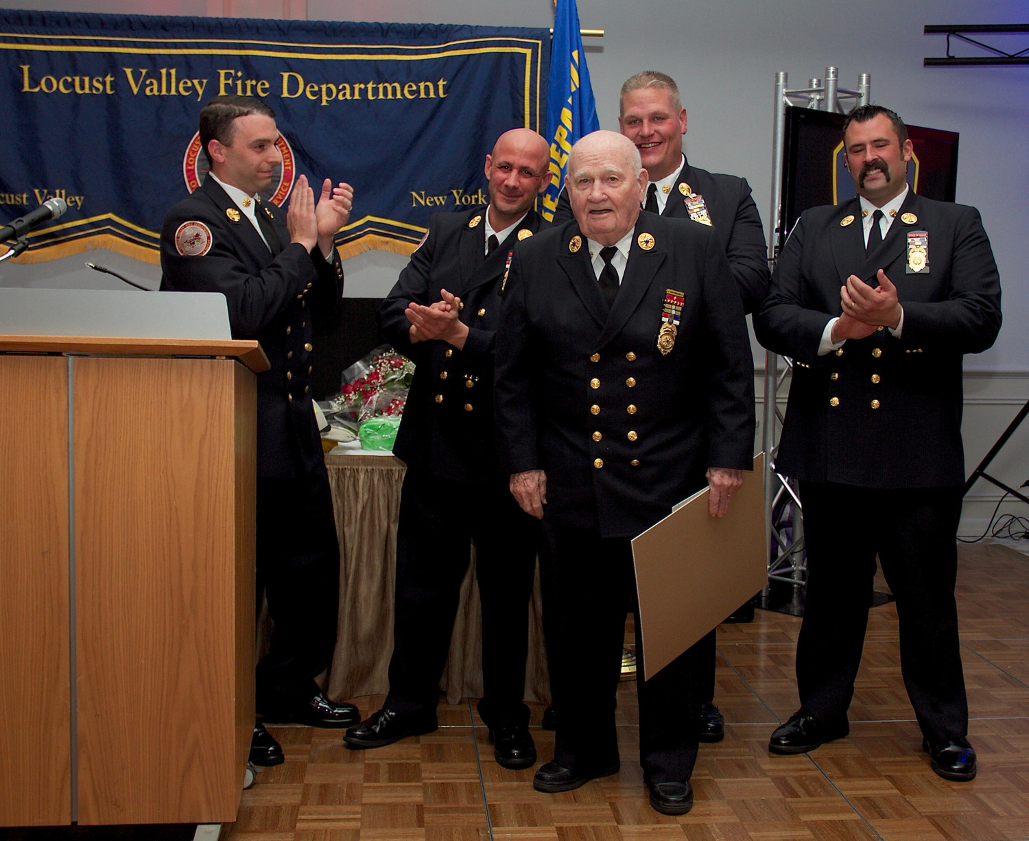 Ex-Chief John Suttie, center at left, was honored for his 60 years of service to the LVFD.