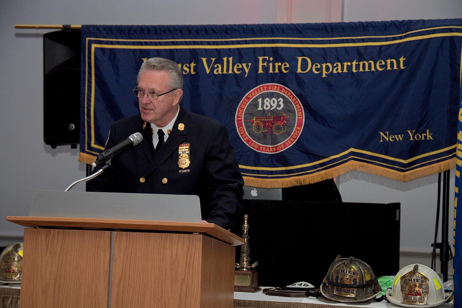 Peter Olson, chairman of the board of fire commissioners, spoke.