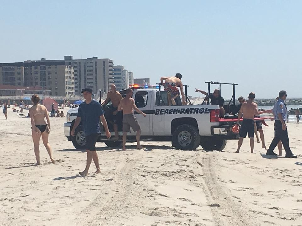 Off-duty Long Beach lifeguards and local surfers pulled several swimmers to safety after they were found in distress close to the jetty at Riverside Boulevard on May 25.