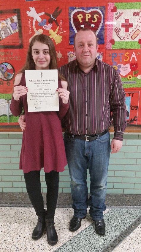 Vokshi and his oldest daughter, Cynthia, posed for a photo after her induction into the National Junior Honor Society. She attends H. Frank Carey High School.