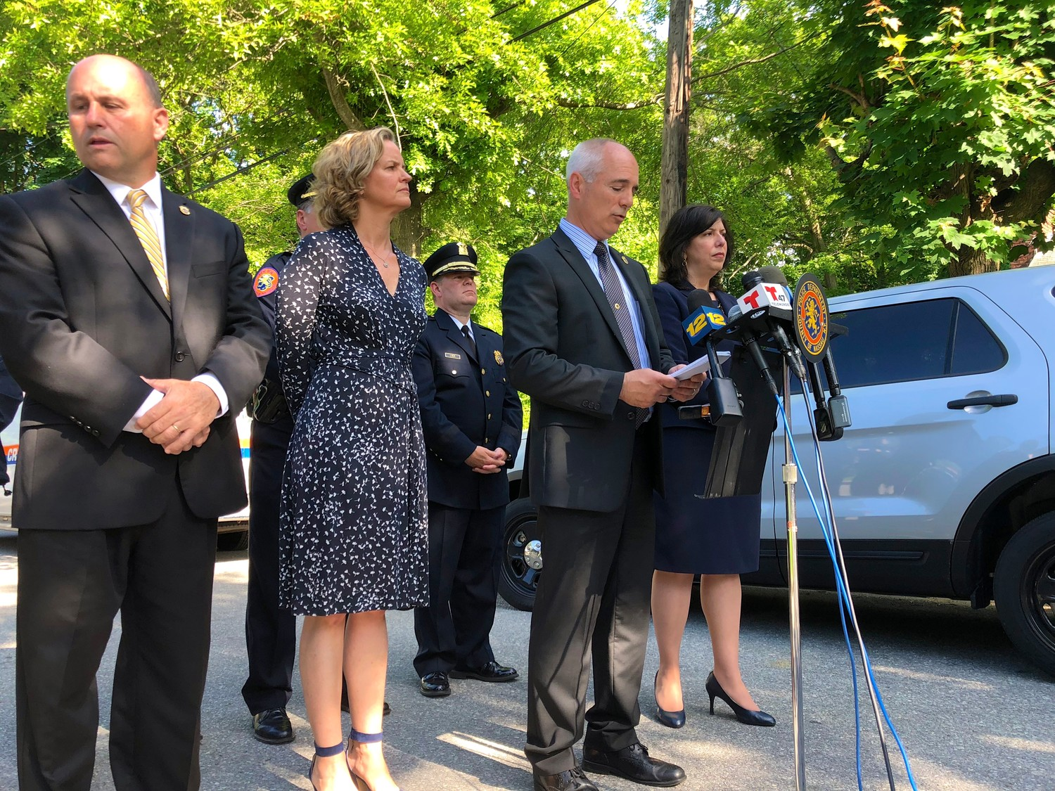 Nassau County officials held a news conference at the east end of Federick Avenue in Roosevelt to announce that they had found a fifth body allegedly killed by the El Salvadoran gang MS-13. At the lectern was Detective Lt. Richard Lebrun. From left were Police Commissioner Patrick Ryder, County Executive Laura Curran and District Attorney Madeline Singas.
