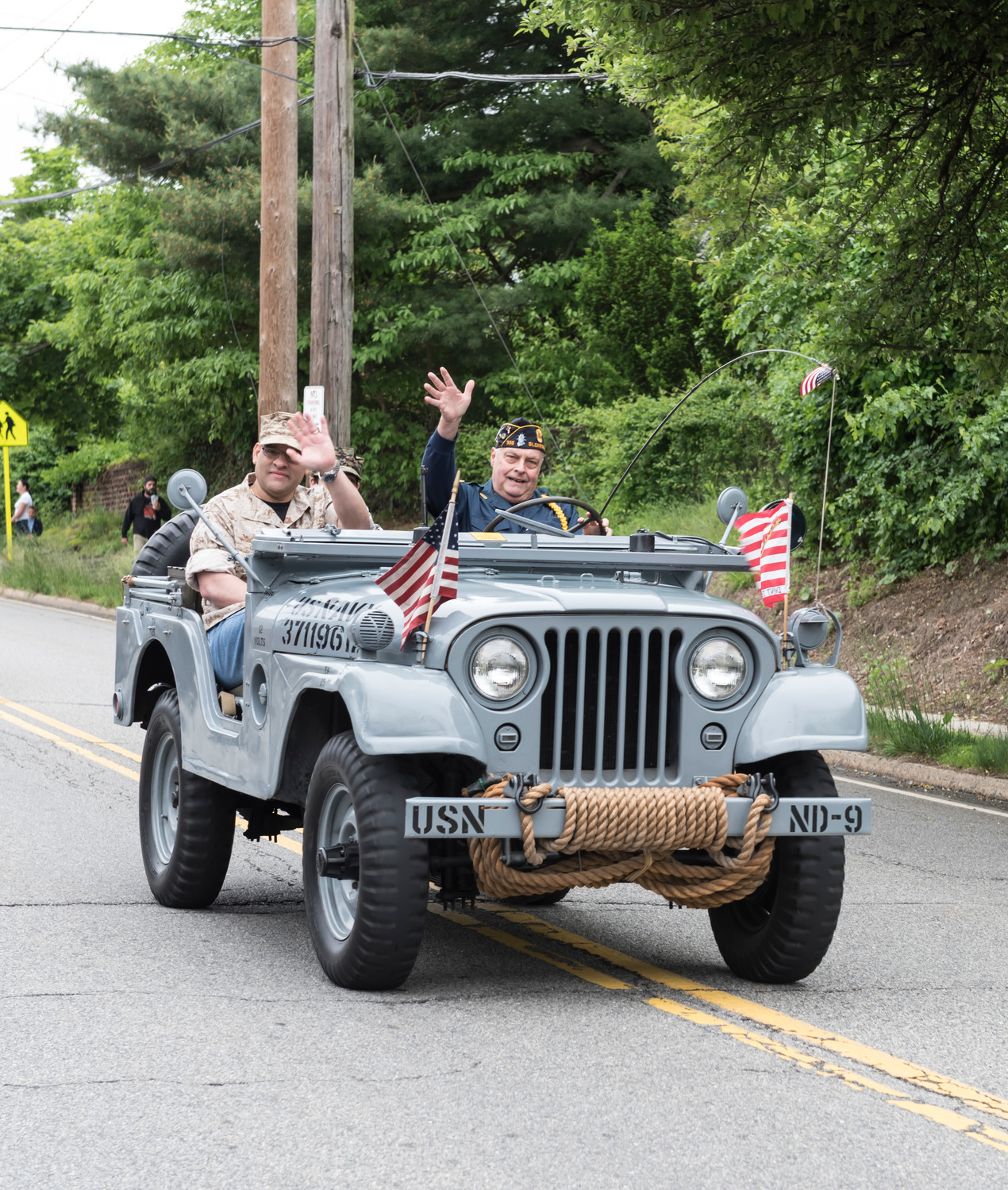 Legionnaire Joe Brandeis showed off his fully restored 1954 original Navy jeep during the parade. He was accompanied by his friend, John Orozco, who served in Desert Storm.