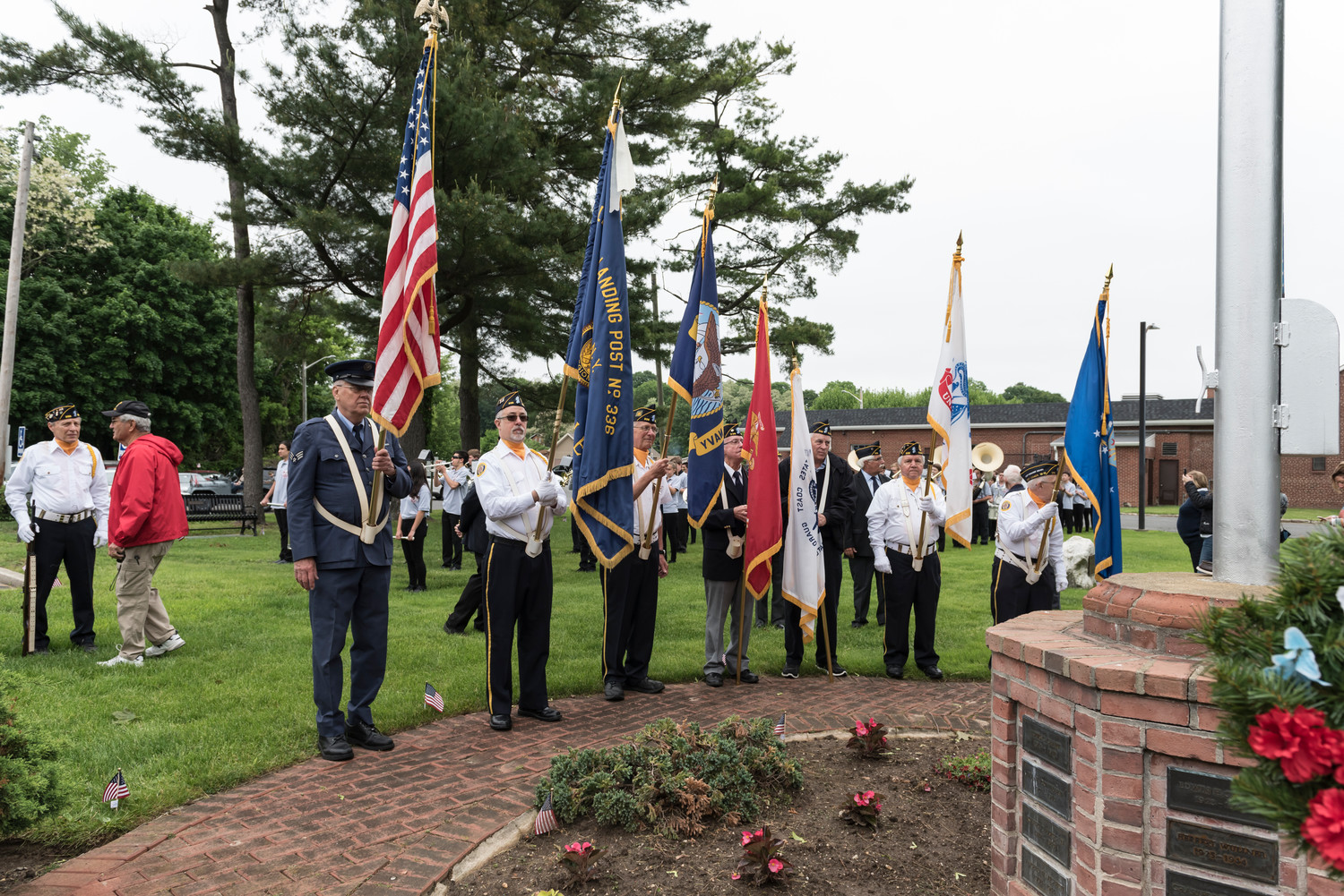 The Glen Head-Glenwood Landing American Legion Color Guard, left, during the ceremonial invocation.
