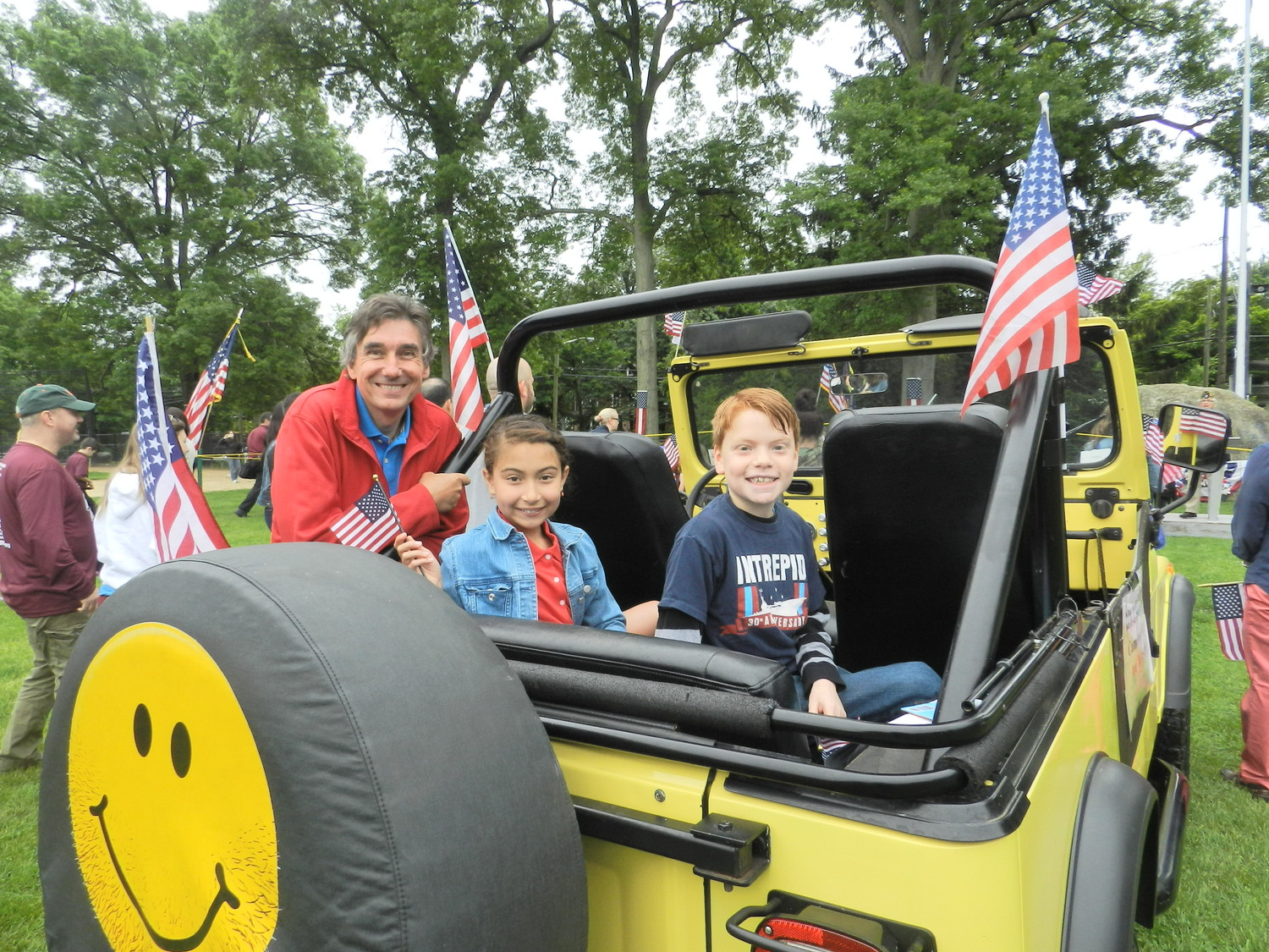 Kevin Horton gave Sea Cliff fourth-graders Ava Varasano and Cameron Miller a lift in his bright yellow Jeep. The 10-year-olds were selected to read their essays at the closing ceremony, which detailed what Memorial Day means to them.