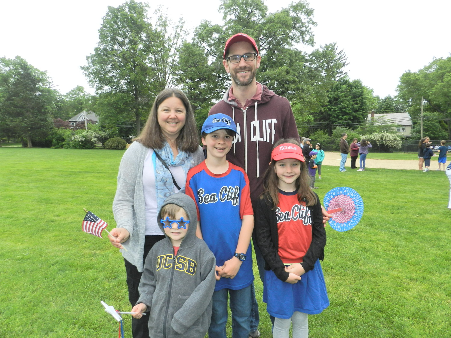 The Lippert family, from left, Courtney, Calvin, Graham, Matt and Maizie, followed the patriotic dress code for the Sea Cliff Memorial Day parade.