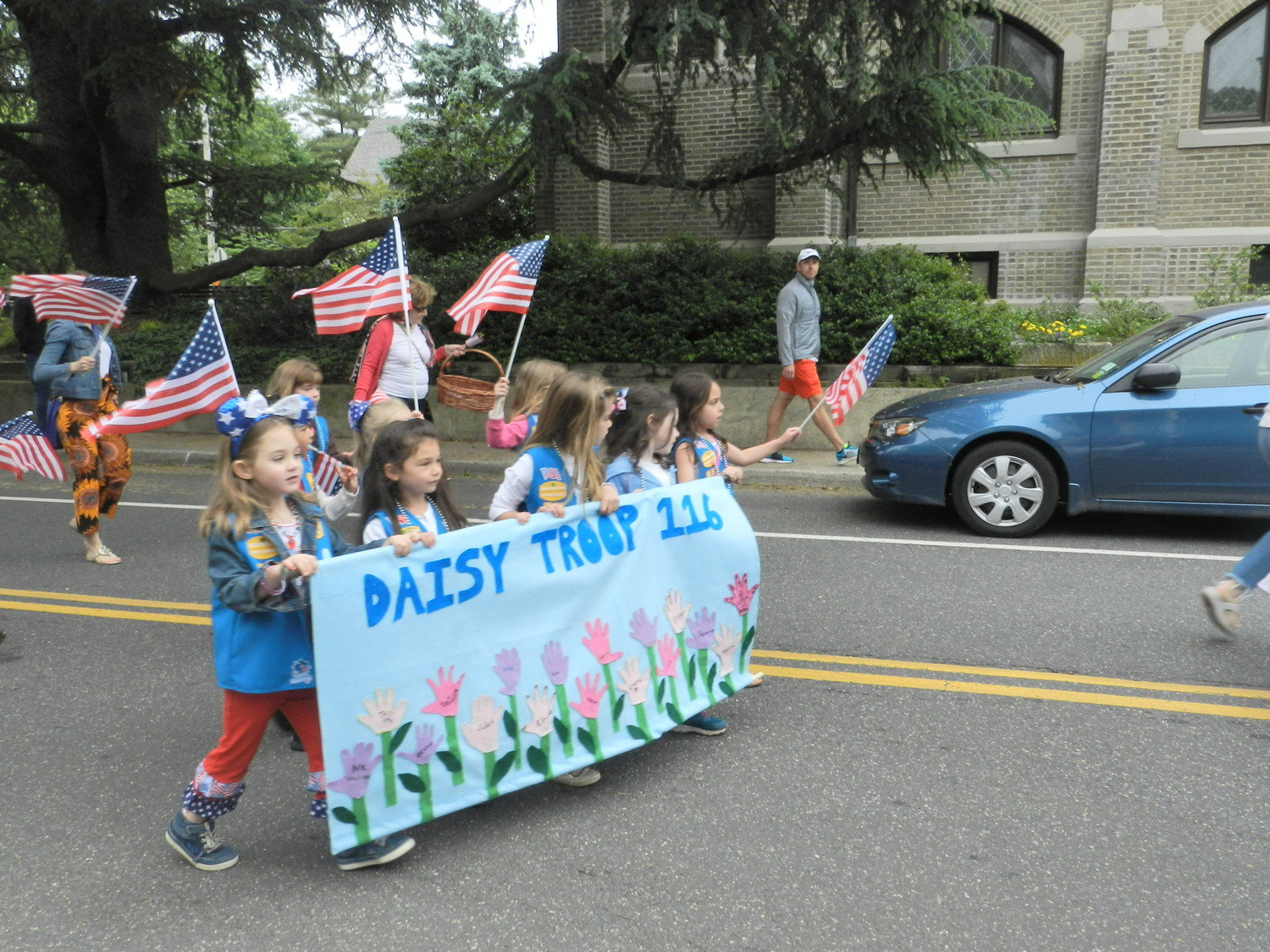 Sea Cliff Daisy troop 116 waved a frenzy of flags while walking in the parade.