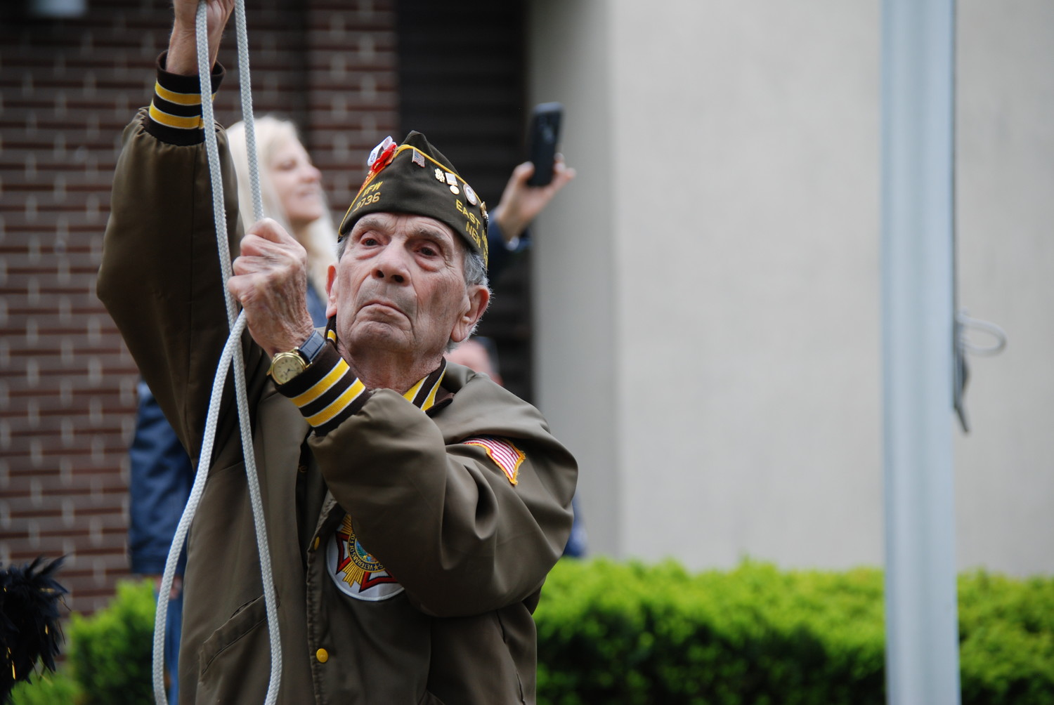 Stephen Gismondi, of Veterans of Foreign Wars Post 2736, lowered the American flag to half-staff during the community's Memorial Day ceremony last year.