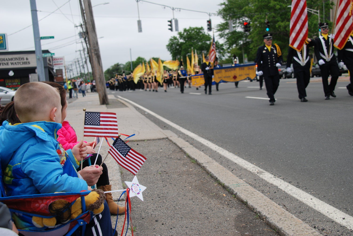 East Meadow residents watched as community organizations and leaders marched in the community's Memorial Day parade.