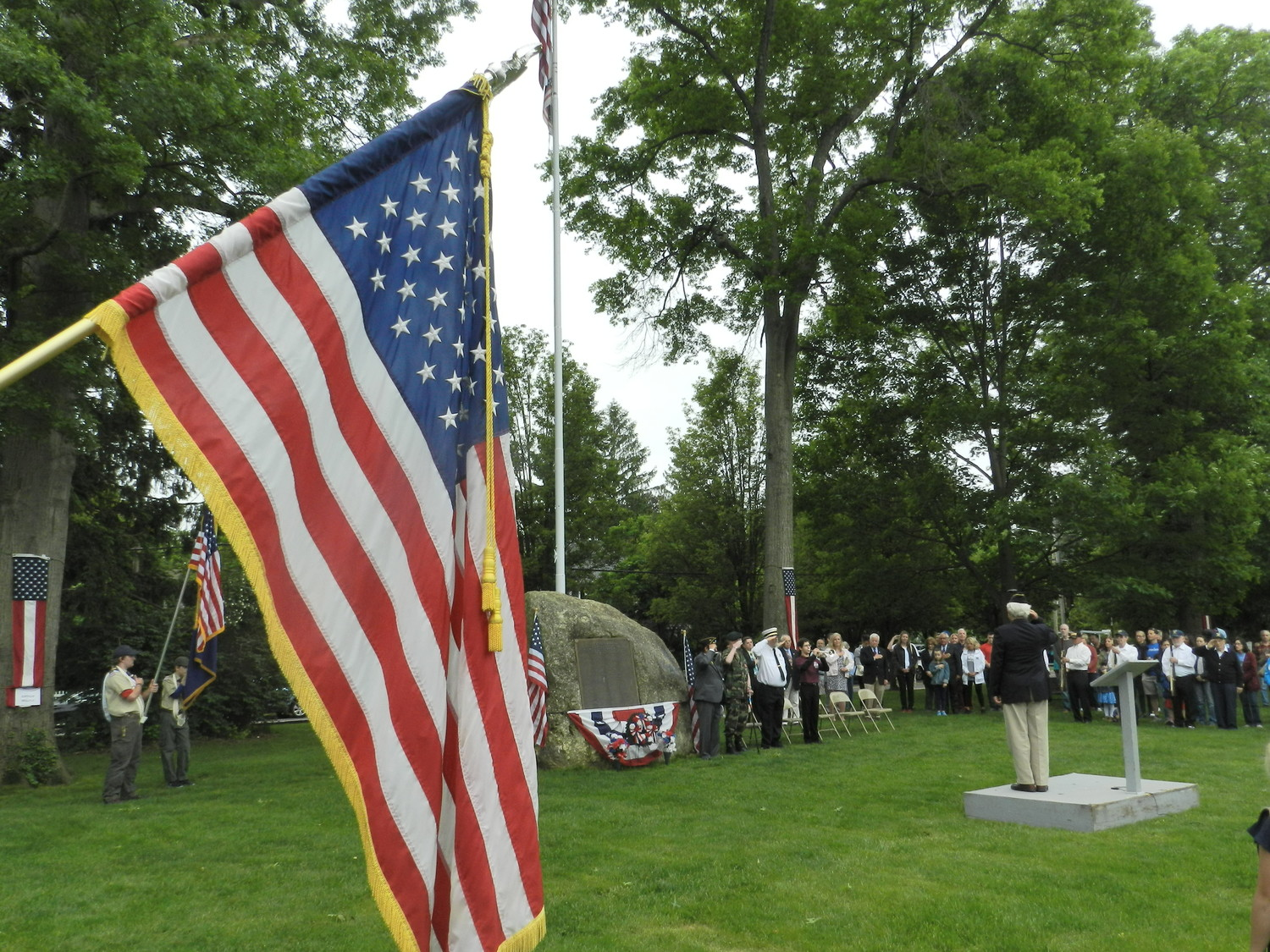 American Legion Commander Phil Como, on the podium, led a salute to honor the members of the military who have given their lives in service to the nation during a ceremony at Clifton Park on Monday.