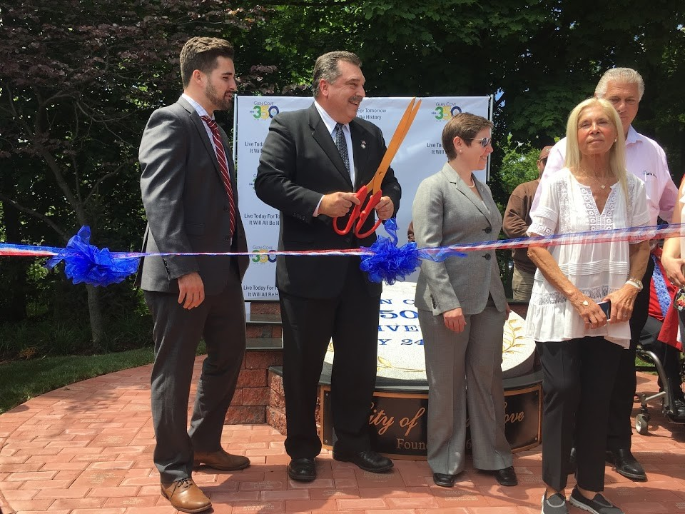 Mayor Timothy Tenke, above, cut the ribbon to officially open the Heritage Garden and 350 monument to the public, with council members Kevin Maccarone and Marsha Silverman.