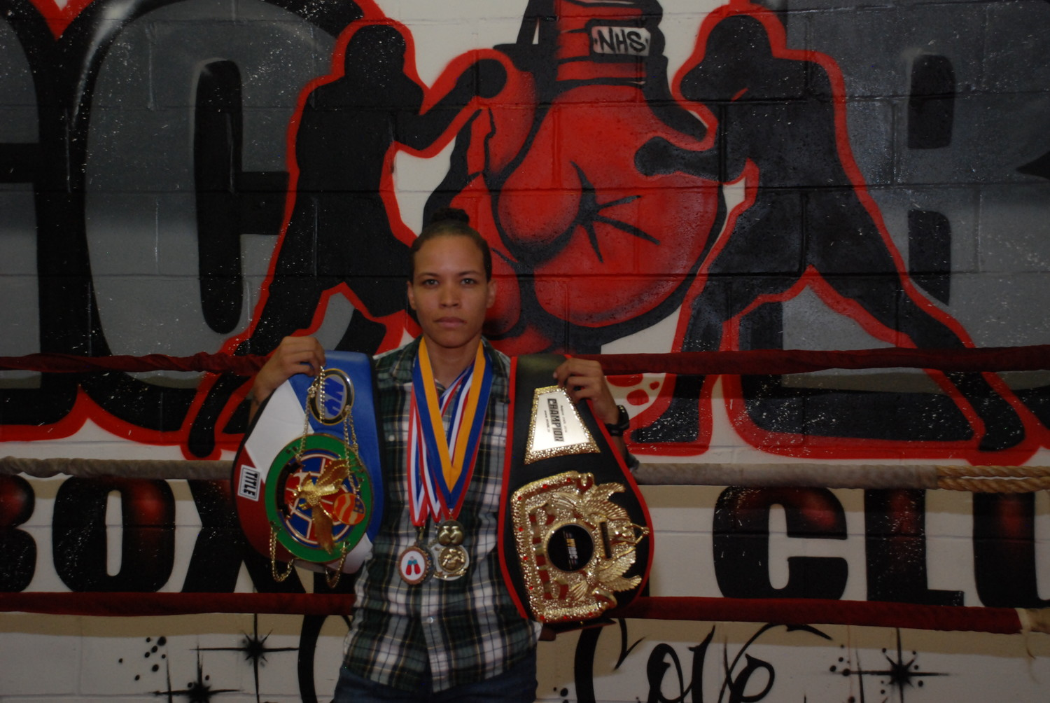 Emily Colon, 31, an alum of the Glen Cove Boxing Club, showed off some of the medals she's won, and the titles, in the form of belts, that she's currently defending. Colon is currently a member of the Puerto Rican Olympic team.