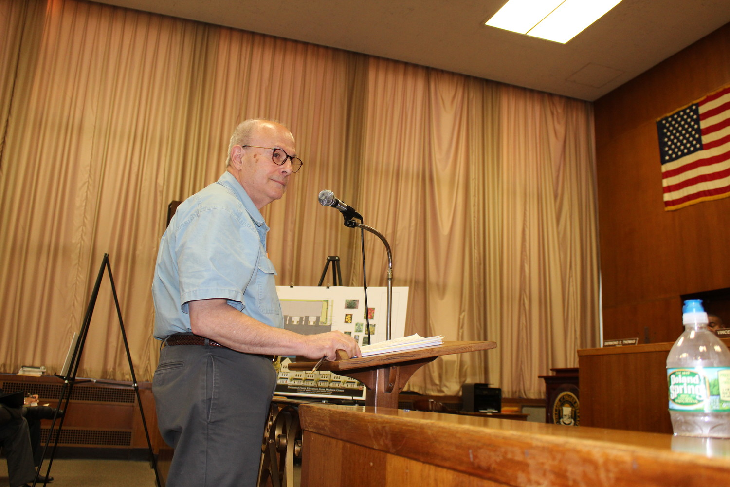 "Resident Mike Belfiore spoke out against what he described as ""spot zoning"" at the site."