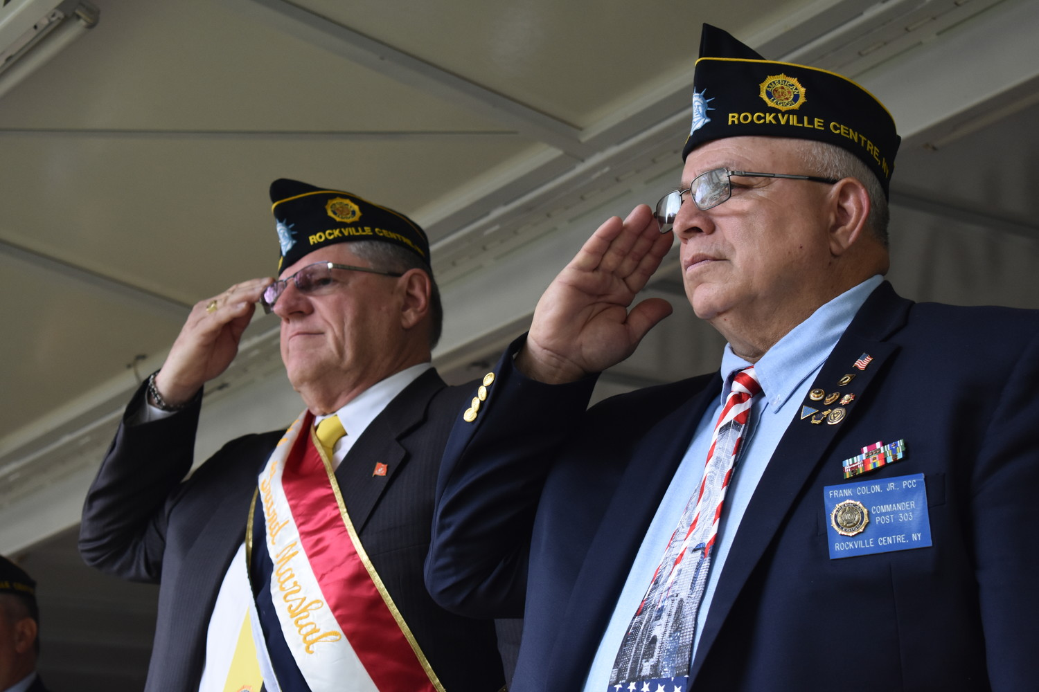 Walter Paruch, above left, grand marshal of Rockville Centre's Memorial Day Parade, and Frank Colon Jr., commander of American Legion Post 303, paid tribute to fallen soldiers.