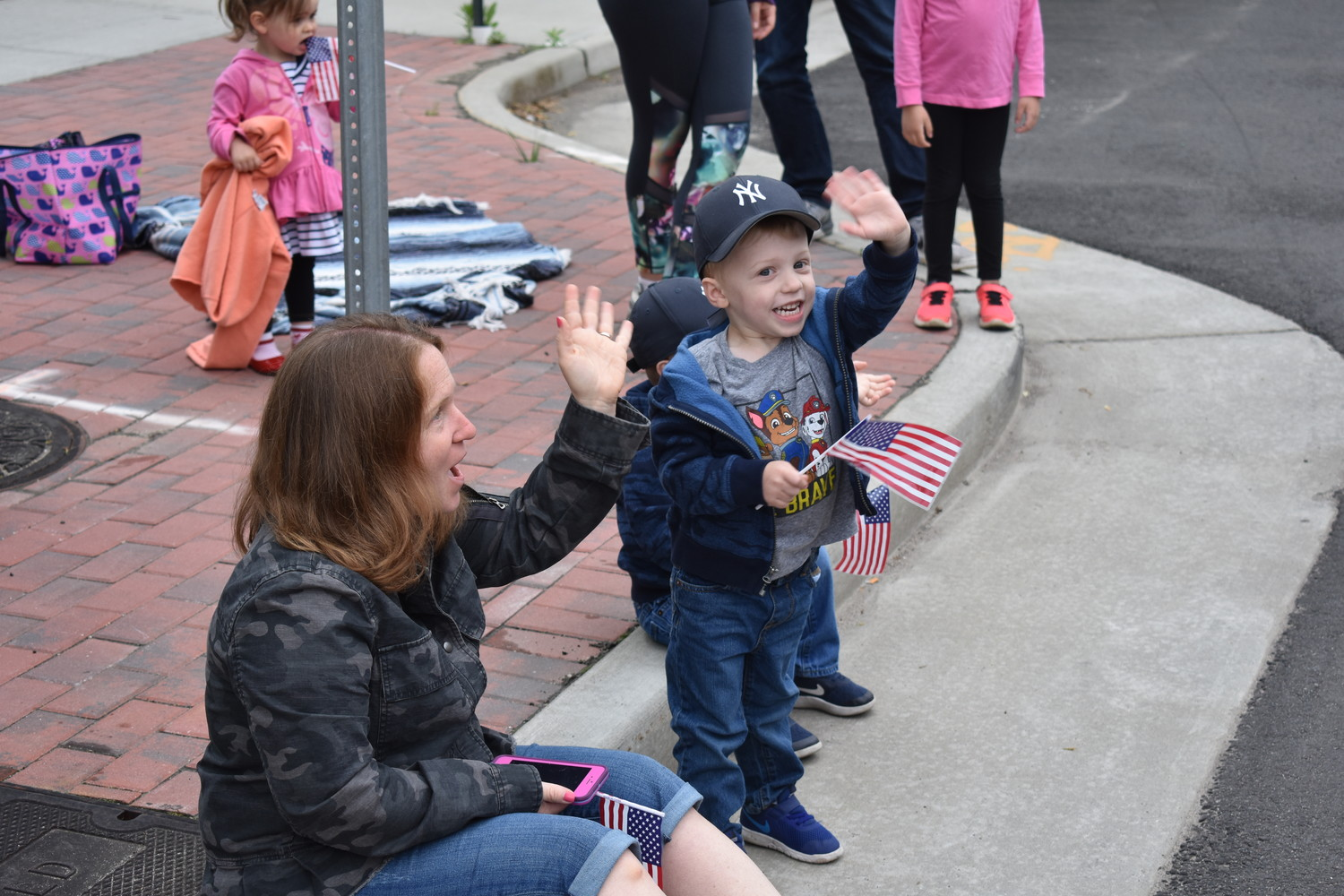 Mason Schaefer, right, with his mother, Denise, waved to firefighters in the parade.