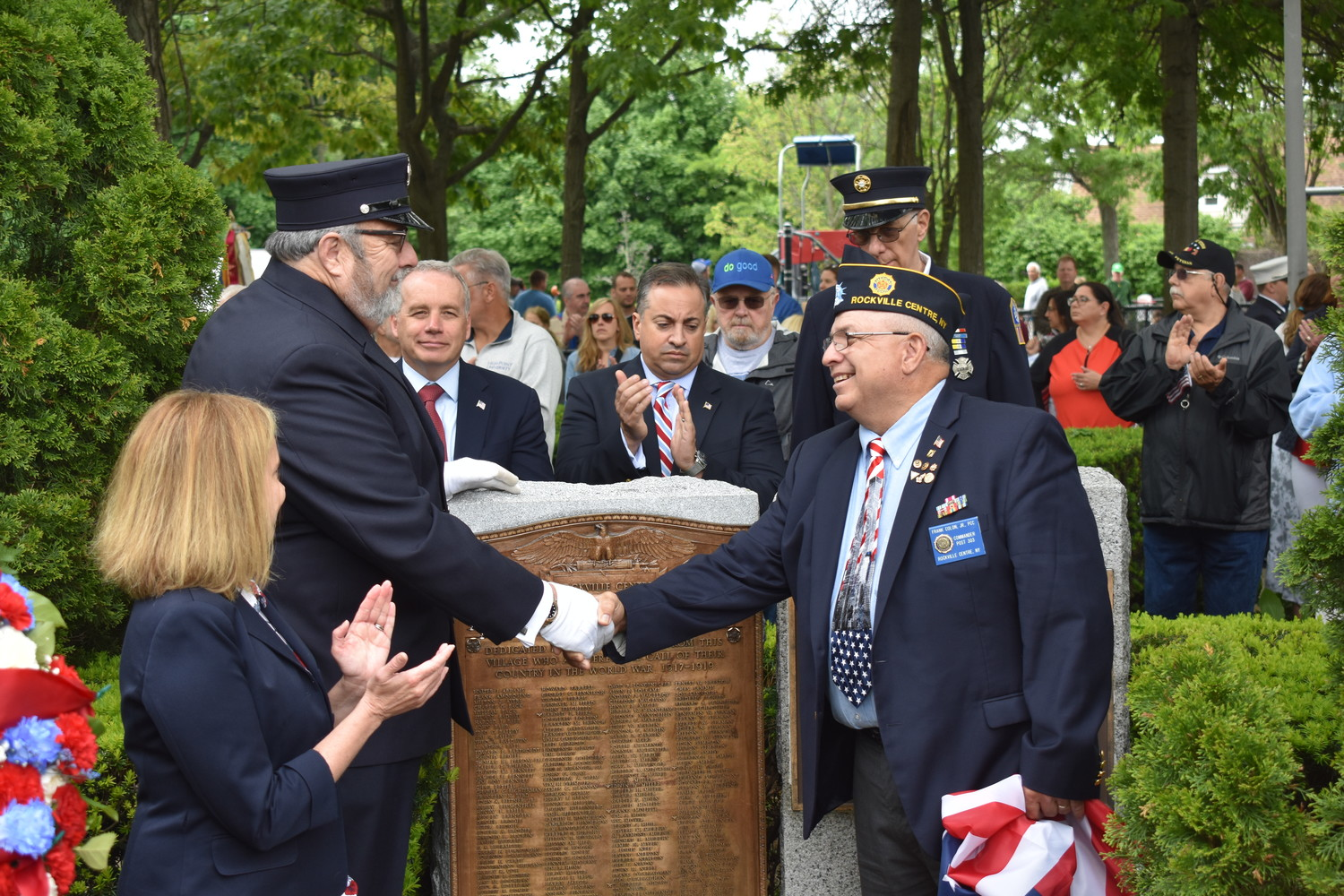 Mayor Francis X. Murray and veteran Frank Colon Jr., commander of American Legion Post 303, unveiled a new monument with the names of Rockville Centre residents who served in World War I. Hempstead Town Supervisor Laura Gillen, and village board trustees Emilio Grillo, Michael Sepe and Ed Oppenheimer looked on.