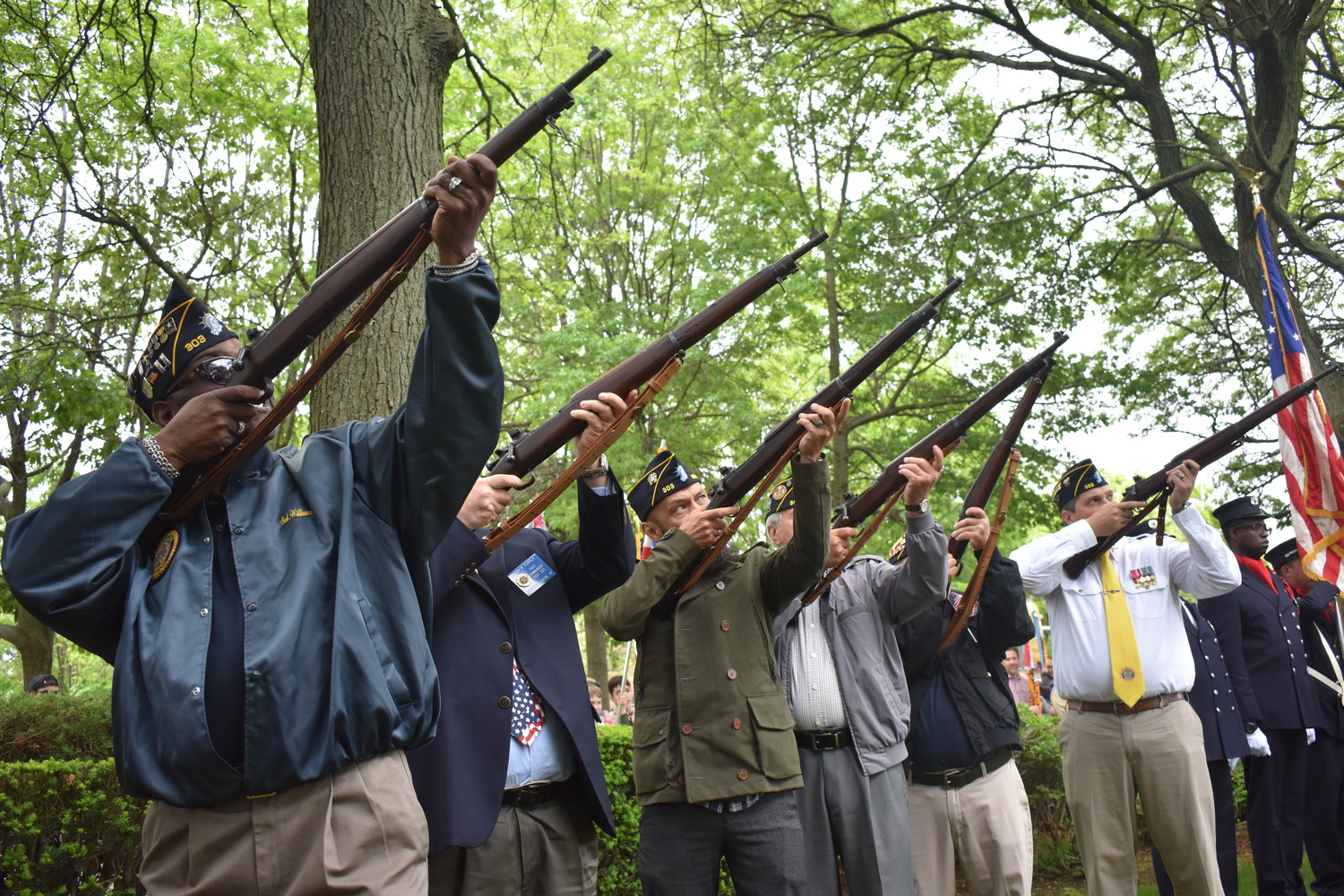 Veterans fired rifles during a ceremony that followed the parade.