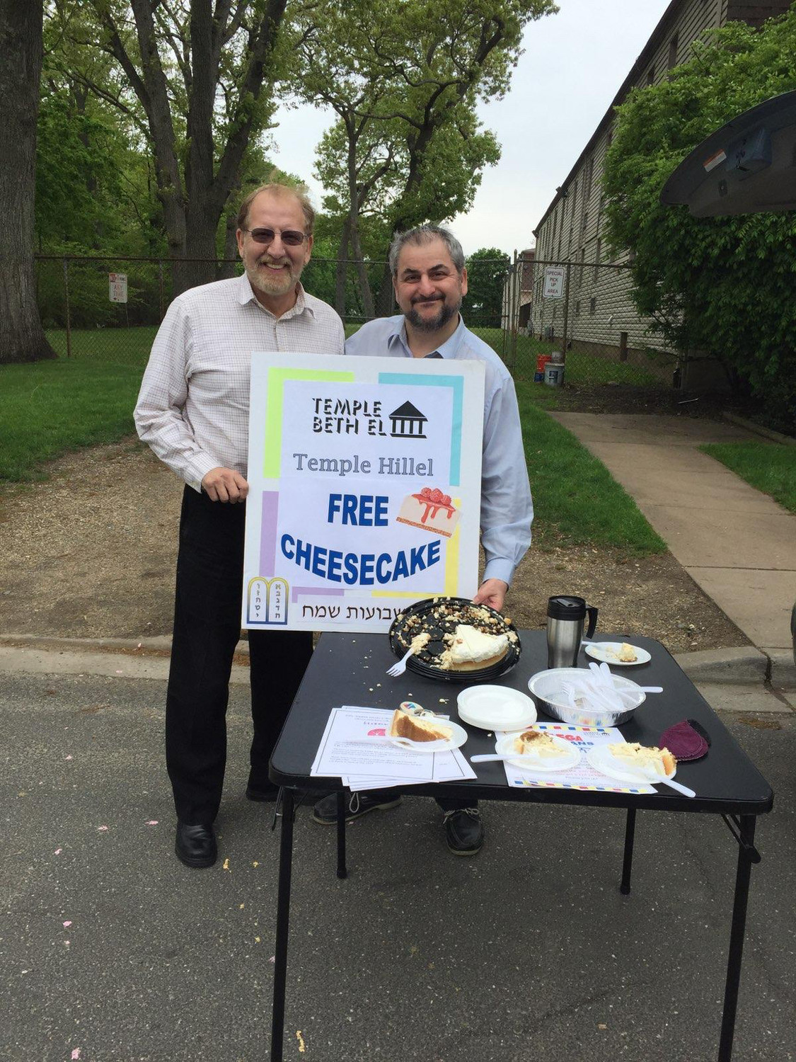 Temple Hillel spiritual leader Rabbi Steven Graber, left, and Rabbi Claudio Kupchik of Temple Beth-El, served cheese cake and spoke to Hewlett High students about the Jewish holiday of Shavuot.