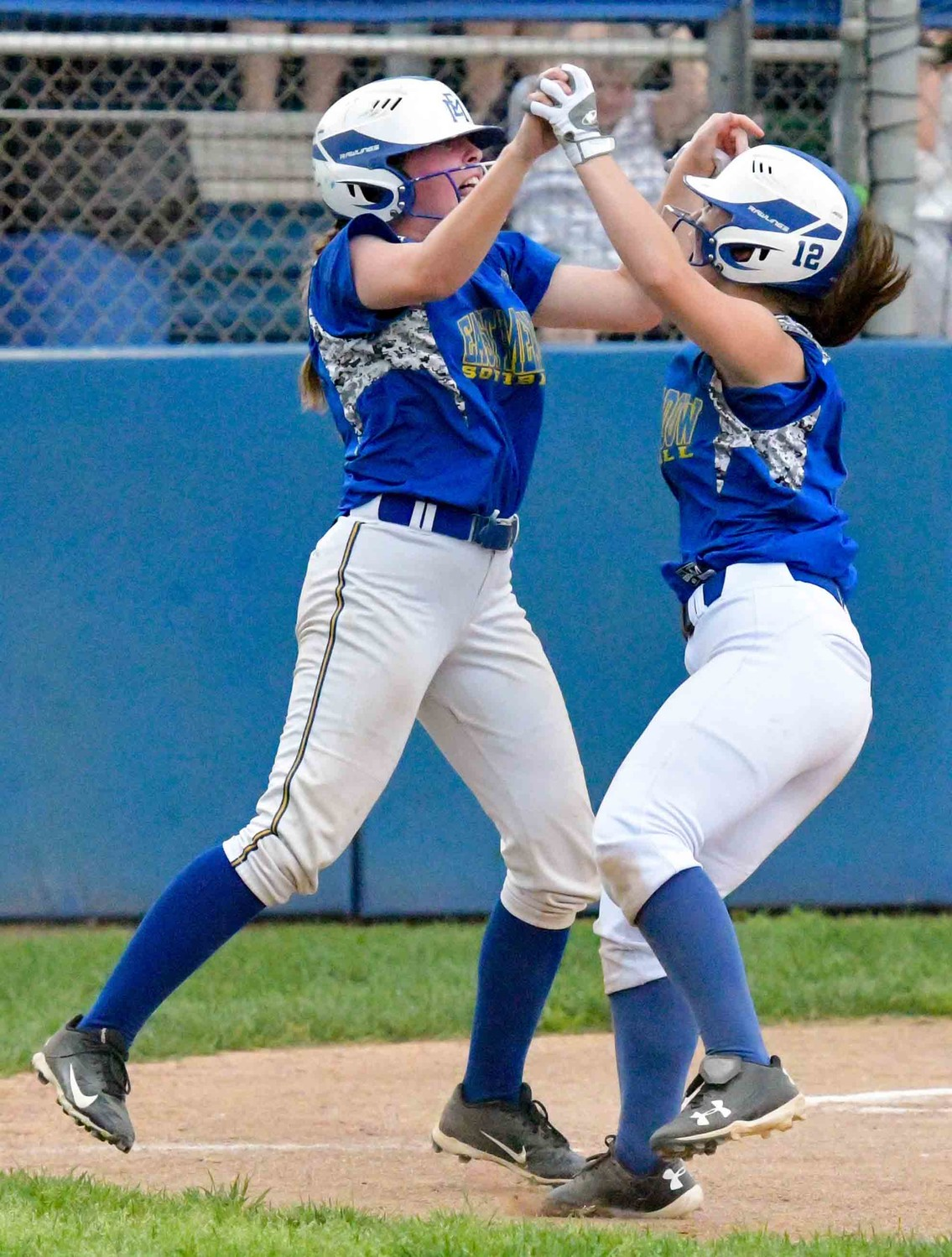 East Meadow's Sara Polansky, left, and Amanda Thompson celebrated around home plate after both scored in the fourth inning of Saturday's Long Island Class AA championship game win over Longwood.