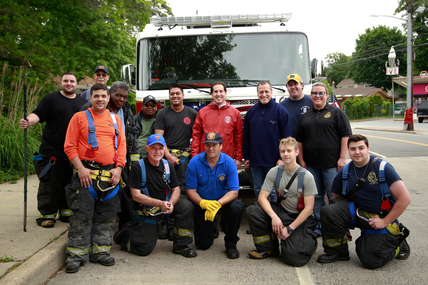 State Sen. Todd Kaminsky, in red above, and Assembly-man Brian Curran, to his left, worked alongside members of the Lakeview Fire Department to clean the park and pond.