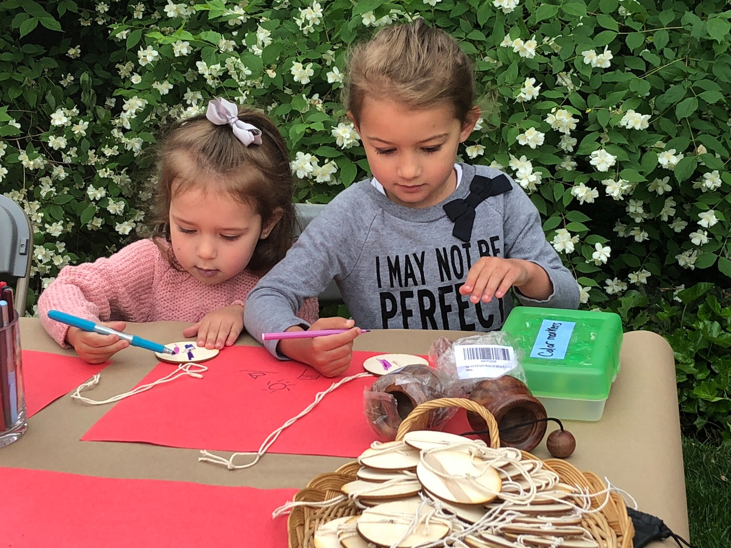 Katerina and Dimitra Belesis, 4 and 3, enjoyed the arts and crafts at Raynham Hall.