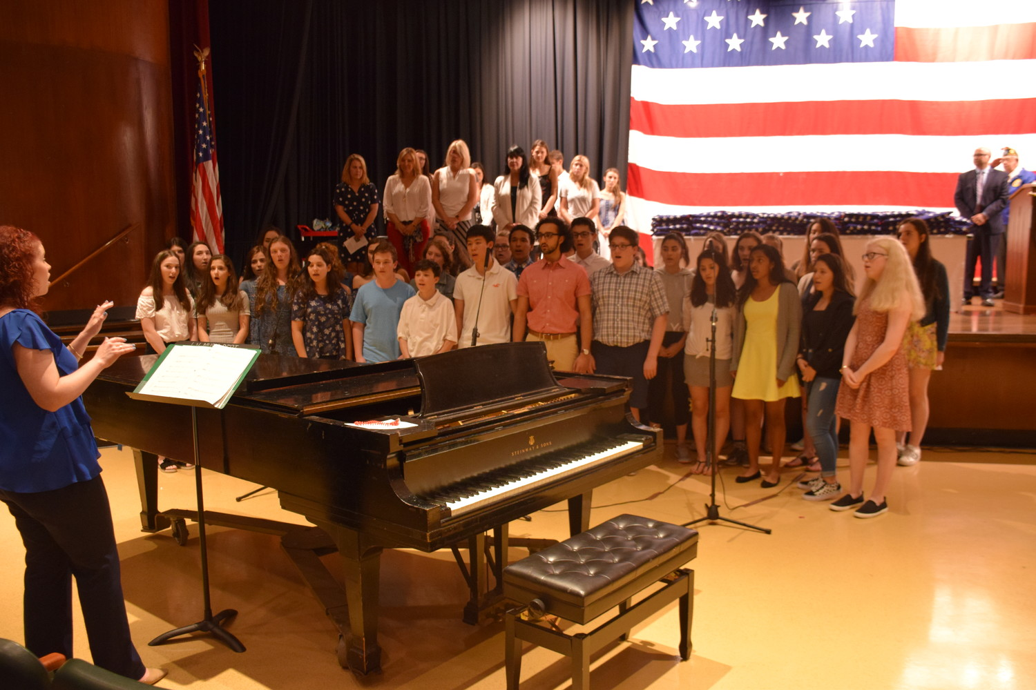 The Locust Valley High School Concert Chorale, led by Allison Hungate-Wood, performed patriotic songs.