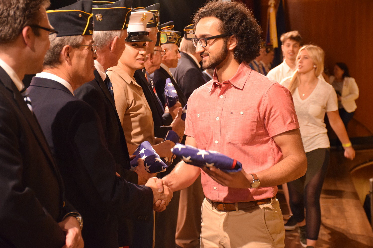 Locust Valley High School Senior Leonardo D'Auria Gupta was honored to accept a flag from a veteran.