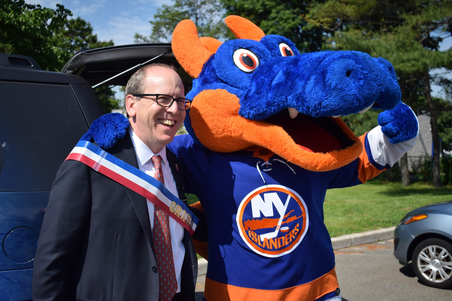 Islanders owner Jon Ledecky with team mascot Sparky. The Islanders have chosen Belmont Park as the home of their future arena, to open in 2021.