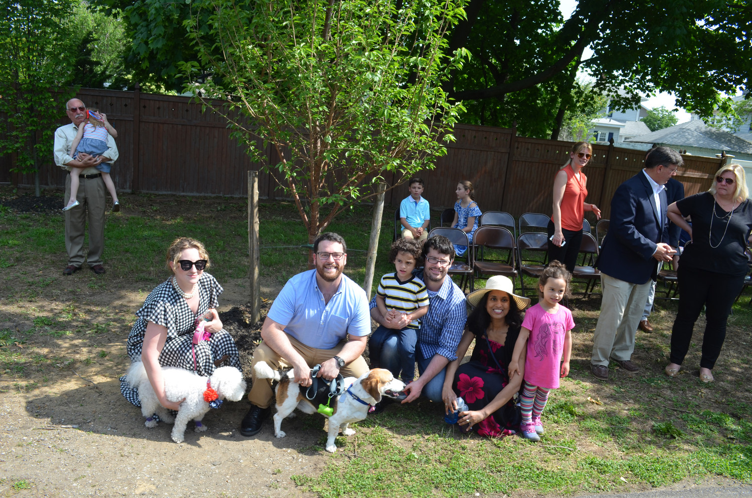 At a tree dedication ceremony in memory of Lynbrook employees who have died, late former Mayor William Hendrick's family Samantha Hendrick, left, John Hendrick, Logan Hendrick, Bill Hendrick Jr., Anna Hendrick, Skylar Hendrick and family dogs Teddy and Penny took a moment to remember him at the tree.