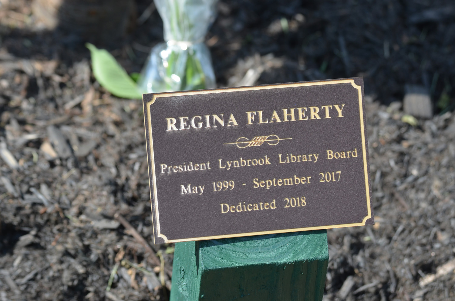 A plaque and tree were dedicated to late former Lynbrook Library Board President Regina Flaherty at a special ceremony.