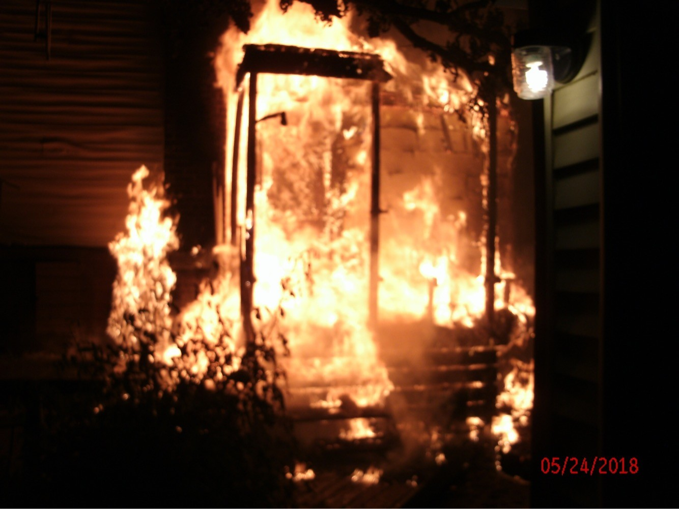 The fire engulfed the rear portion of the house.