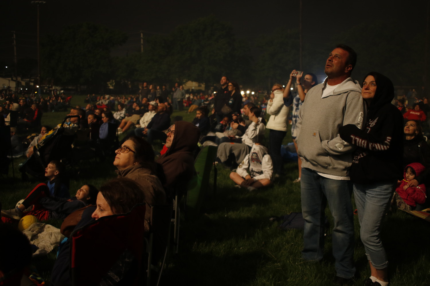 About 3,000 residents came to the Patriots' Day fireworks show at Greis Park on Memorial Day. Barbara Hieronymus and Robert Livingstone, far right, watched the grand finale in awe.