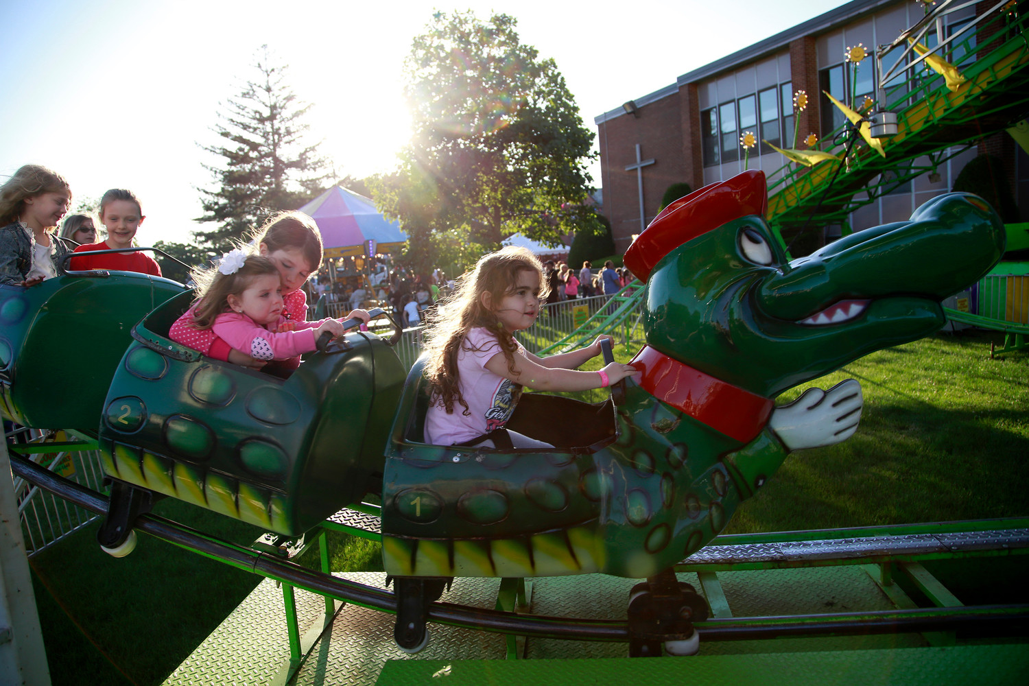 "Sofia Leonardo, 4, took the lead car on the ""Go Gator"" roller coaster at St. Anthony's 47th Annual Feast in 2016. It was one of many attractions over the weekend at the church grounds on Anchor Avenue."