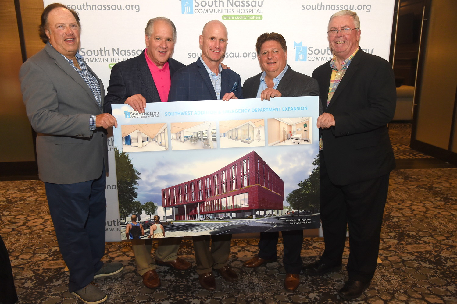 Golf outing co-chairs Jeff Greenfield, left, Tony Cancellieri, honorees Matt Whalen and Joel Schneider and South Nassau president and CEO Richard Murphy with a rendering of the hospital's upcoming southwest addition.