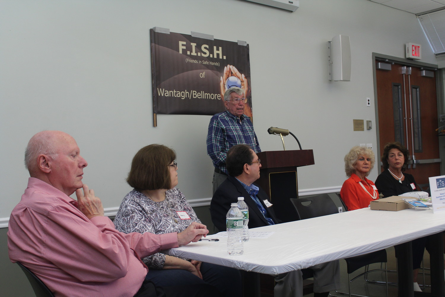 Paul Desroches, Director of the FISH of Wantagh, addressed his fellow volunteers at the podium during the group's annual business meeting on May 26.