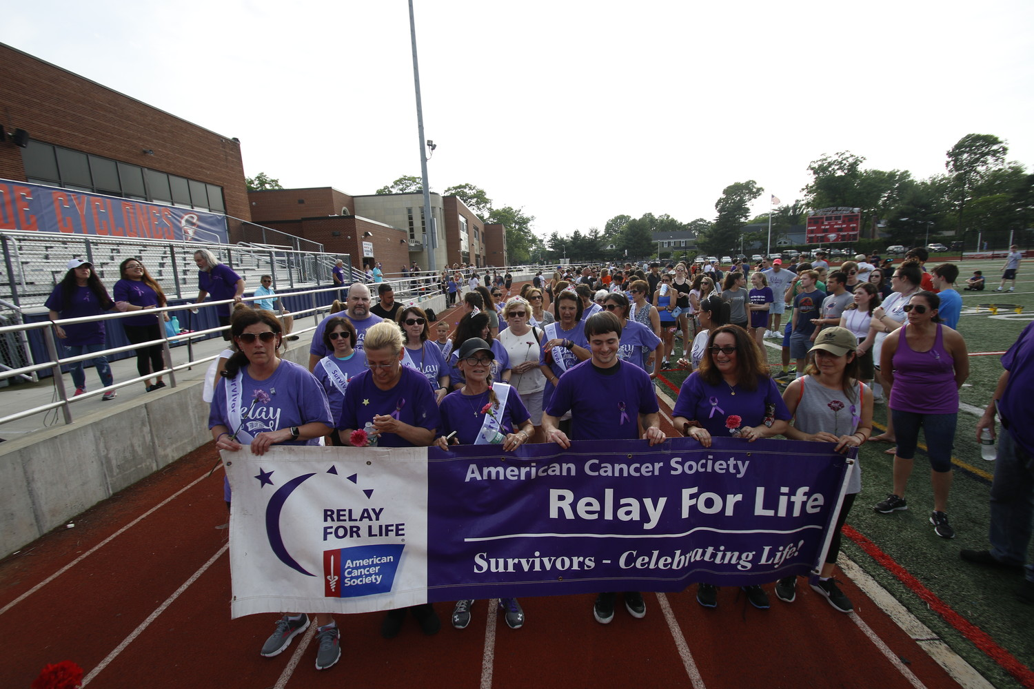 Cancer survivors took a lap around the track at South Side High School's first Relay For Life on June 2.