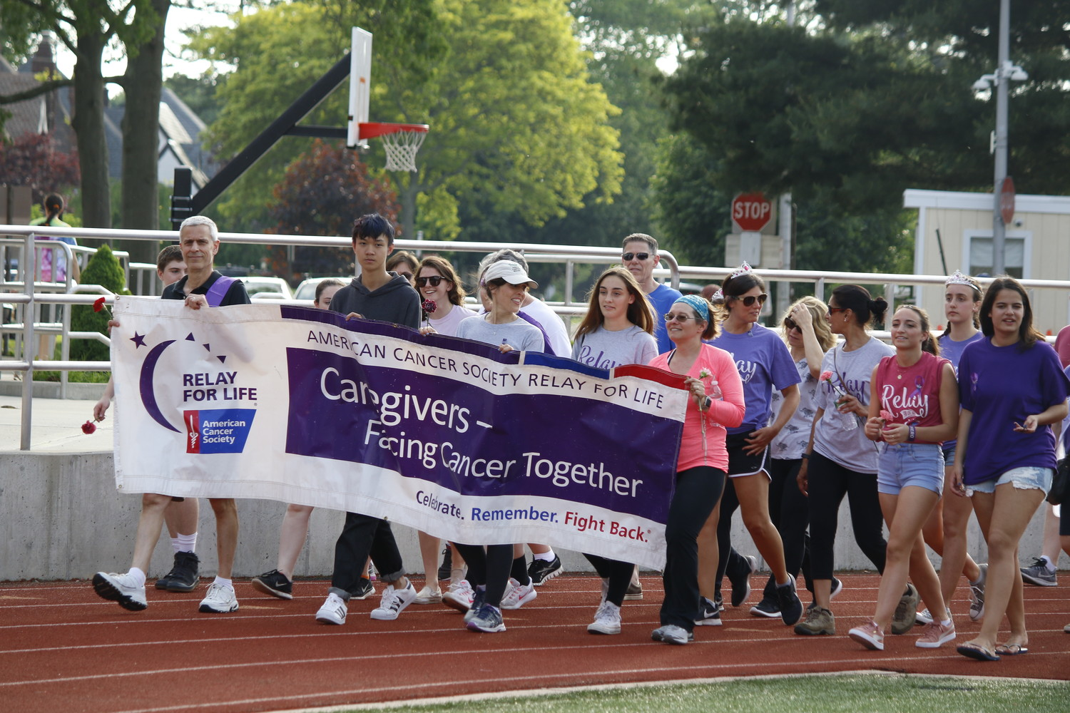 Students, and other community members joined together for the caregivers lap.