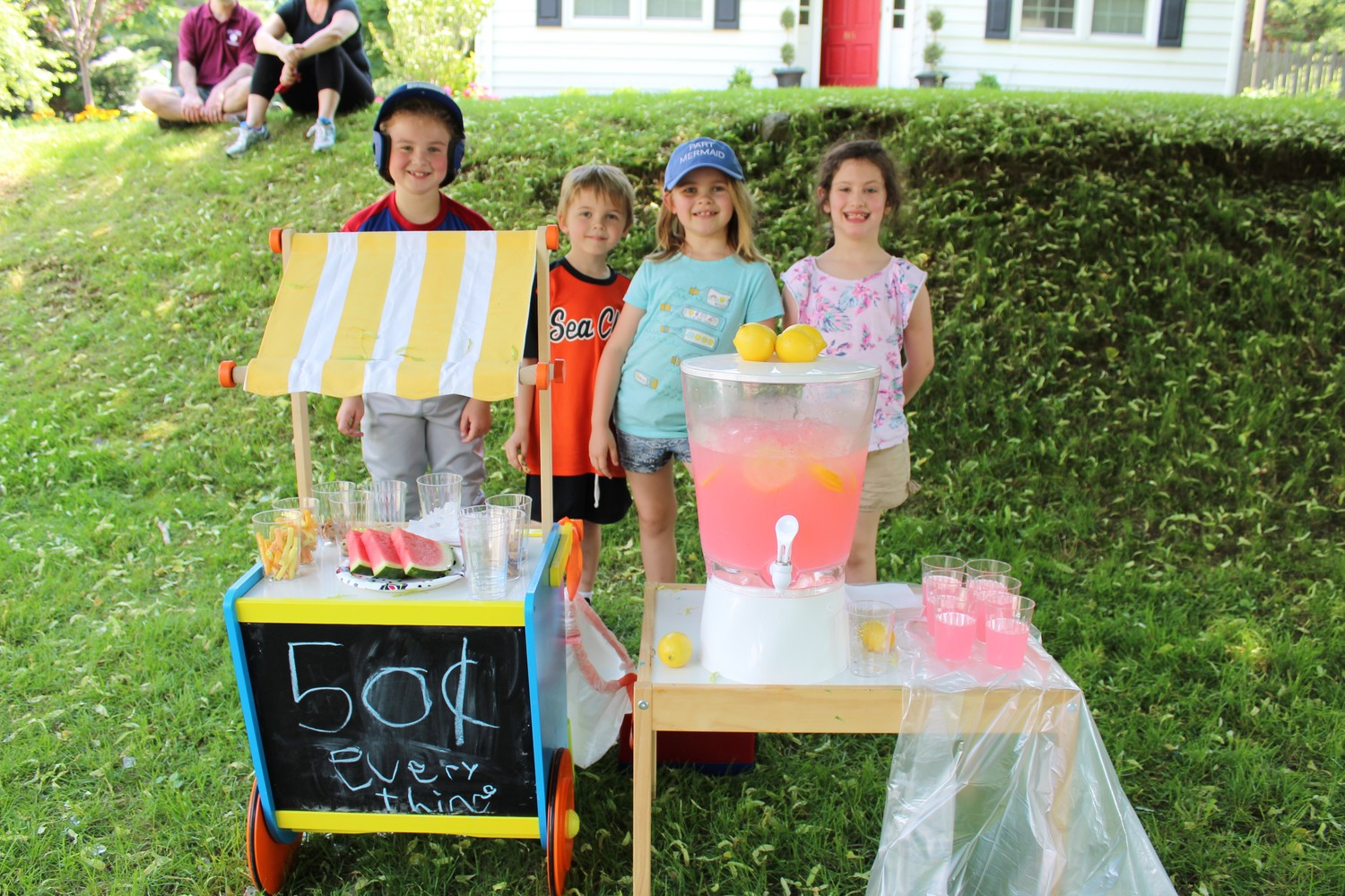 Lily Sussman, far left, made it back from her softball game just in time to help her friends Ben and Mckenzie Loftus and Stella Cashman sell lemonade and other goodies on Sea Cliff's annual Garage Sale Day. More photos, Page 9.