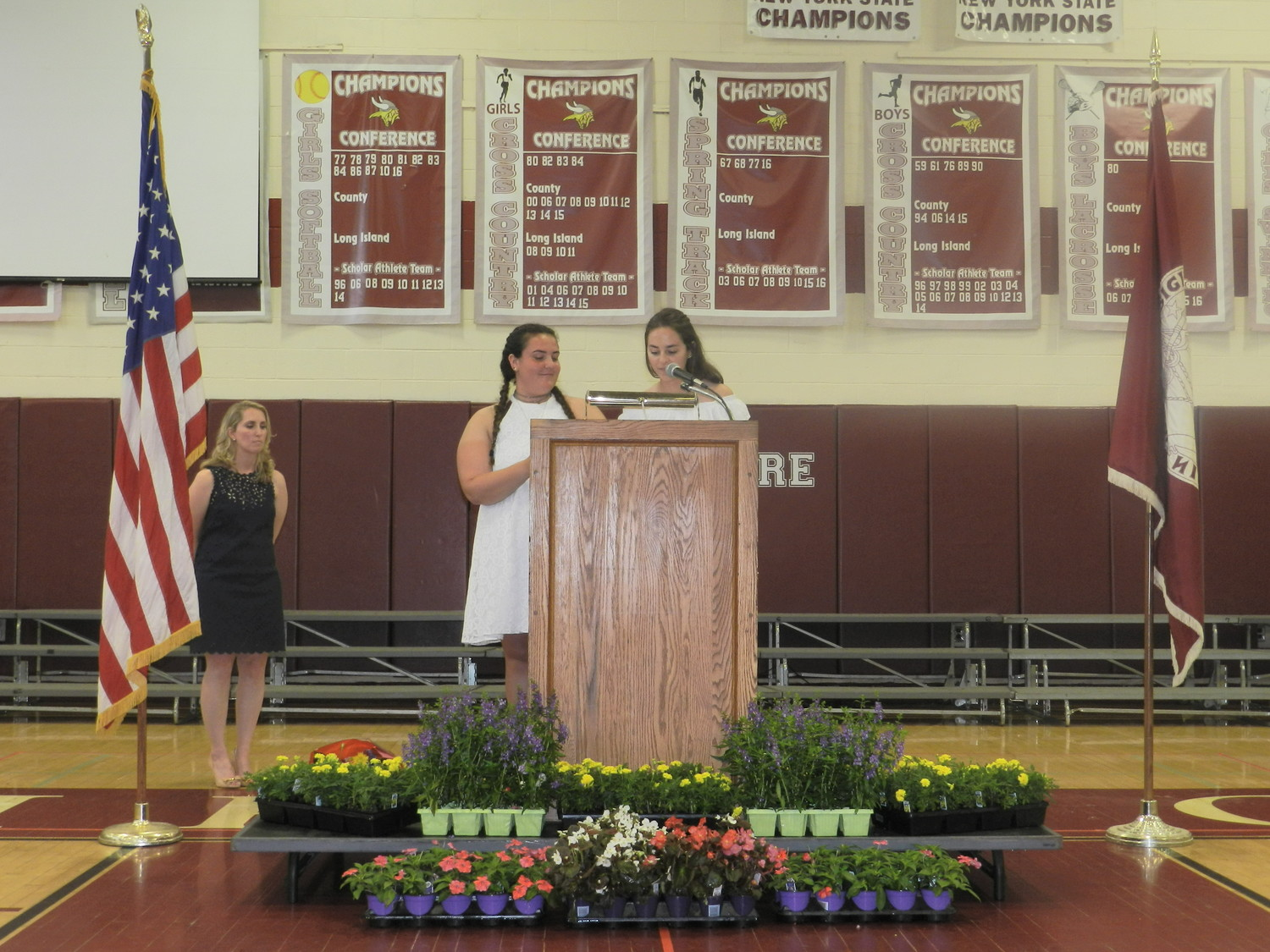 Student Government Organization co-presidents Lindsey Golden and Emilie Biolsi, at podium, addressed the student body one last time.
