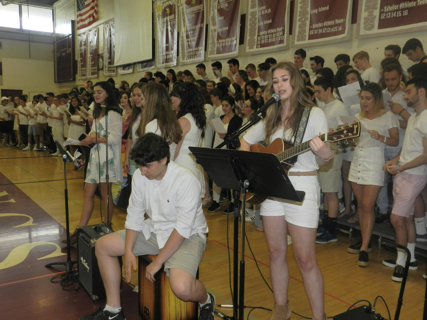 During senior song, Ella Oswald, right, and Dylan McGinley, provided music accompaniment as the class sang together.