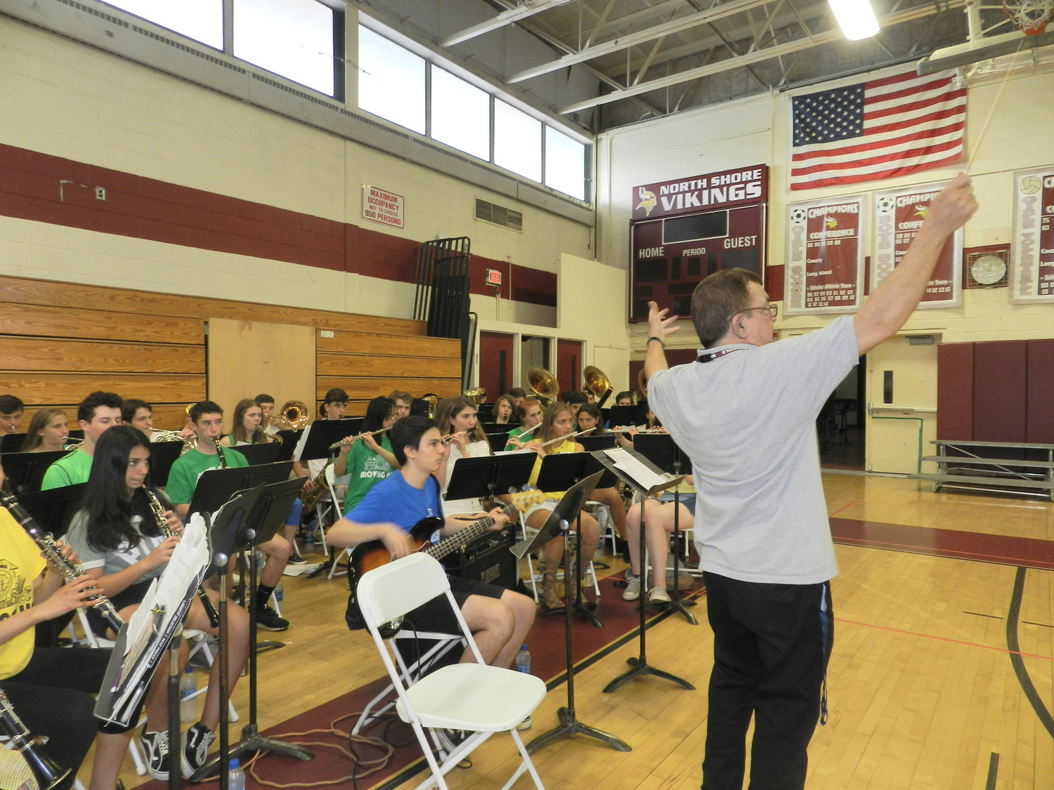 Conductor Dave Soto led the North Shore High School wind symphony as they played a processional march song at the Moving Up ceremony.