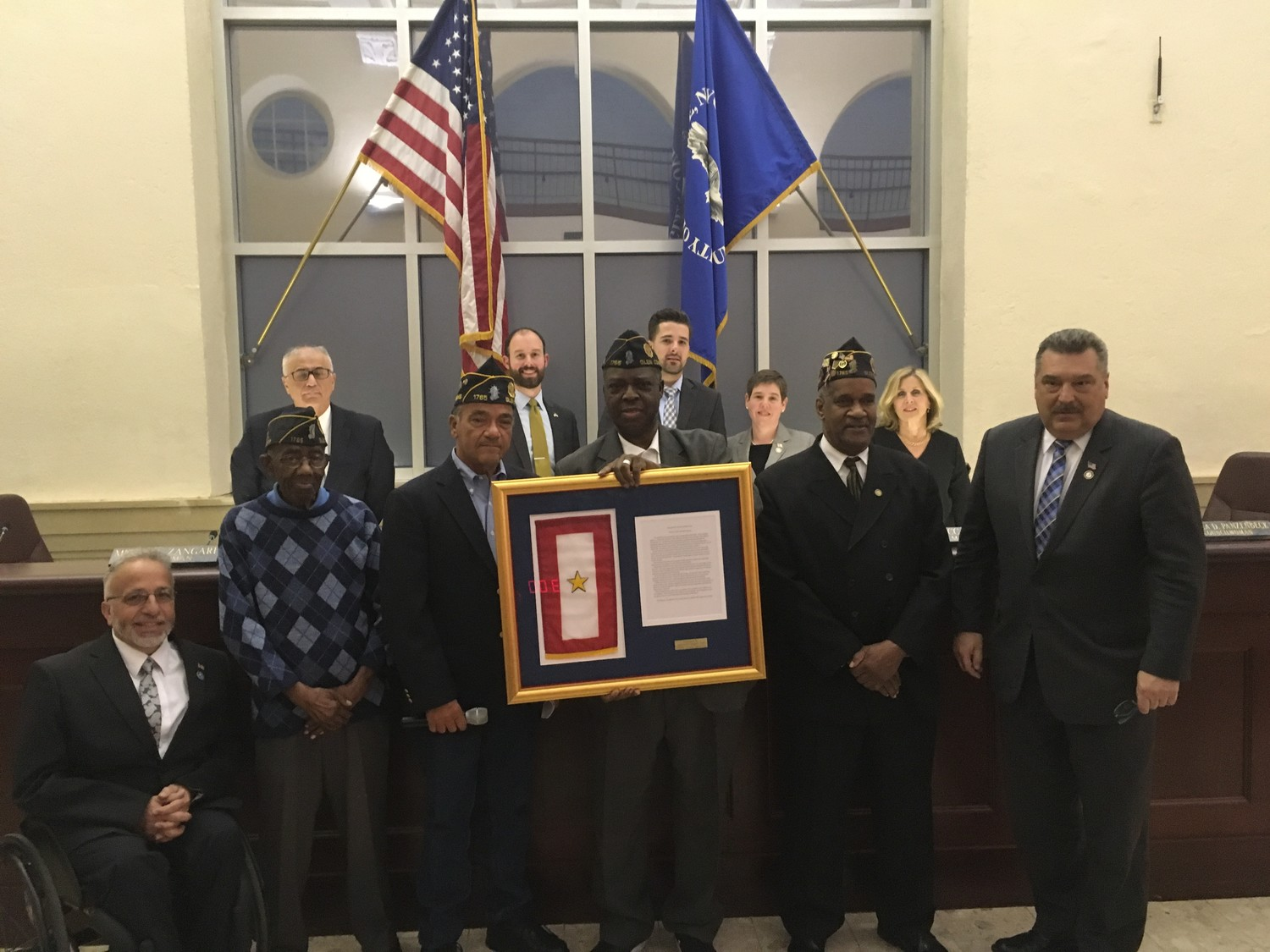 At an April 26 meeting of the city council, the Young-Simmons American Legion Post donated a Gold Star flag to the city, to be hung in City Hall.