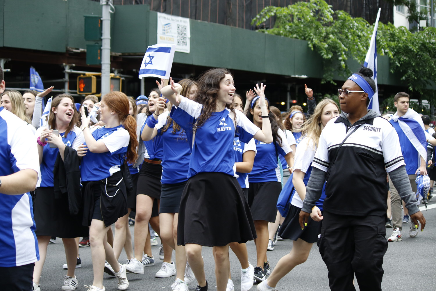 HAFTR High School students, at far left, appeared to enjoy their time in the Israel Day Parade last Sunday.