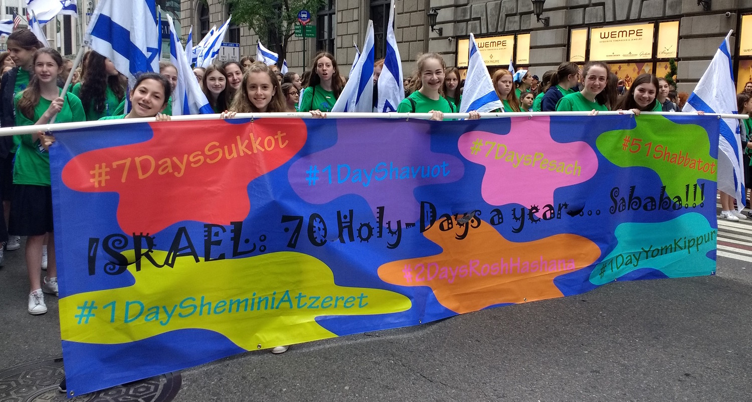 Shulamith School's banner, above, reflected the parade's theme and Jewish holidays throughout the year.